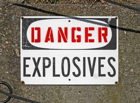 danger explosives, warning message on signboard, stress environment photo