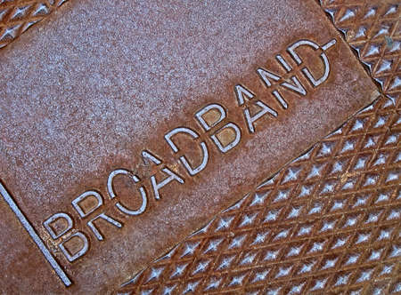 cable broadband as text on metal surface, modern telecommunication details