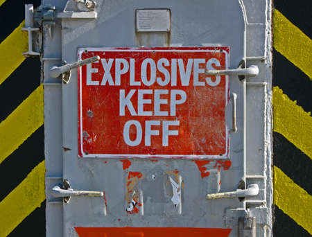 explosives keef off, warning message on red signboard, danger environment photo