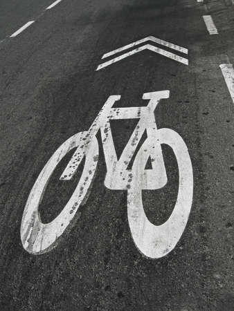 white bike painted sign on grunge asphalt, healthy transportation security photo