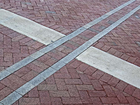 abstract cross sign on red brick square, modern architecture details photo