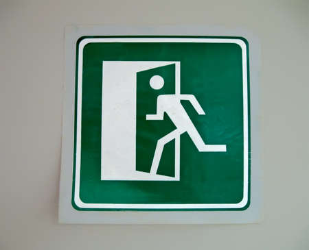 abstract green exit sign on the wall, security details Stock Photo - 15766490