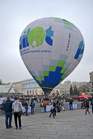 KIEV, UKRAINE - OCT 20: Kiev's Club of aeronautic sport presents air balloon on Kreshatik street in Kiev, Ukraine on October 20, 2012. People observe the big air balloon before it start flying.