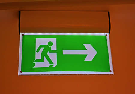 abstract green exit sign, modern security details photo
