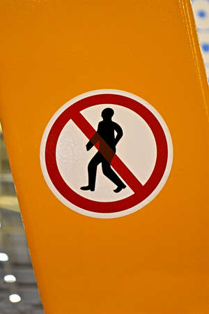 no entrance  entrance prohibited  red sign with man silhouette on yellow surface, security details Stock Photo - 16449572
