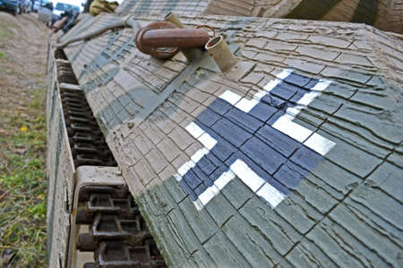focus on sign. nazi sign on vintage tank with camouflage painting, stress nostalgia details photo