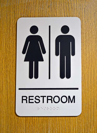 restroom (toilet) sign on wooden surface, healthy environment photo