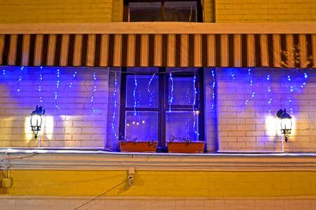 garnald lamp light with illumination on window, holiday details