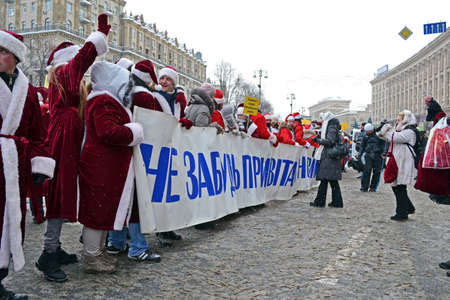 KIEV - DEC 22: Santa Clasus (Did Moroz) greets people on December 22, 2012 in Kiev, Ukraine. Santa Clasus Parade starts on Dec 22 on Kreshatik street in Kiev. Stock Photo - 17063291
