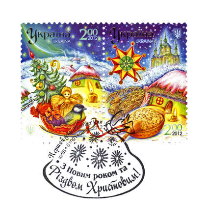 UKRAINE - CIRCA 2012: cancelled stamp on Premier jour holiday envelope printed in UKRAINE, shows Ukrainian winter landscape and Christmas gifts, circa 2012. Happy New Year and Marry Christmas as text. paper isolated on white background. Stock Photo - 17202246