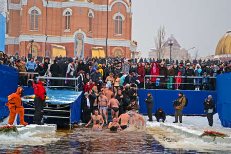 KIEV - JAN 19: Epiphany (Kreshchenya) morning near Svjato-Pokrovskiy Cathedral on January 19, 2013 in Kiev, Ukraine. People plunging into ice-cold water three times as it helps body became more resilient to illness. Epiphany known since 988 AD. Stock Photo - 17437192