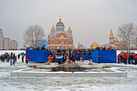KIEV - JAN 19: Epiphany (Kreshchenya) morning near Svjato-Pokrovskiy Cathedral on January 19, 2013 in Kiev, Ukraine. People plunging into ice-cold water three times as it helps body became more resilient to illness. Epiphany known since 988 AD. Stock Photo - 17437185