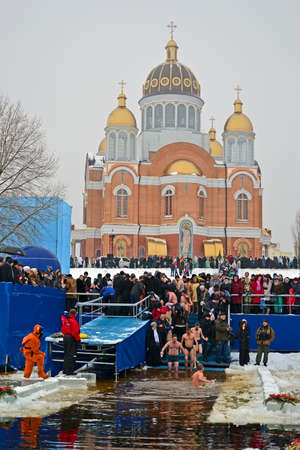sanctification: KIEV - JAN 19: Epiphany (Kreshchenya) morning on January 19, 2013 in Kiev, Ukraine. People plunging into ice-cold water three times as it helps body became more resilient to illness. Epiphany known since 988 AD.