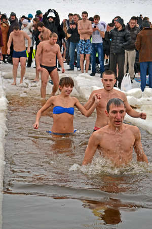 KIEV - JAN 19: Epiphany (Kreshchenya) morning near Svjato-Pokrovskiy Cathedral on January 19, 2013 in Kiev, Ukraine. People plunging into ice-cold water three times as it helps body became more resilient to illness. Epiphany known since 988 AD. Stock Photo - 17437186