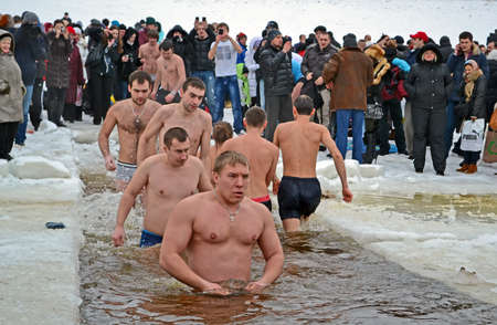 KIEV - JAN 19: Epiphany (Kreshchenya) morning near Svjato-Pokrovskiy Cathedral on January 19, 2013 in Kiev, Ukraine. People plunging into ice-cold water three times as it helps body became more resilient to illness. Epiphany known since 988 AD. Stock Photo - 17437187