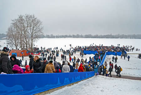 sanctification: KIEV - JAN 19: Epiphany (Kreshchenya) morning near Svjato-Pokrovskiy Cathedral on January 19, 2013 in Kiev, Ukraine. People plunging into ice-cold water three times as it helps body became more resilient to illness. Epiphany known since 988 AD.