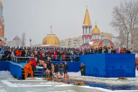 baptizing: KIEV - JAN 19: Epiphany (Kreshchenya) morning near Svjato-Pokrovskiy Cathedral on January 19, 2013 in Kiev, Ukraine. People plunging into ice-cold water three times as it helps body became more resilient to illness. Epiphany known since 988 AD.