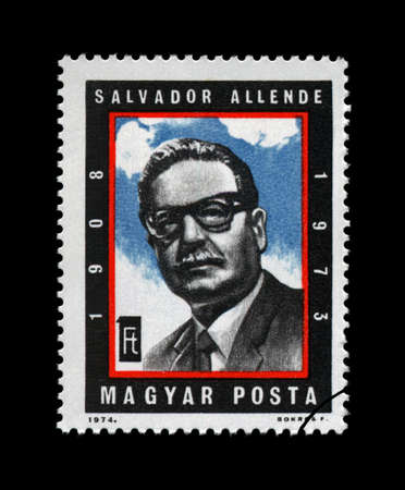 salvador allende: HUNGARY - CIRCA 1974  stamp printed in Hungary, shows Salvador Allende  Gossens  1908-1973 , president of Chile  1970-1973 , circa 1974  vintage post stamp isolated on black background   Editorial