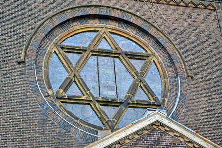 fusing: jewish star on vintage church, old stone wall details Stock Photo