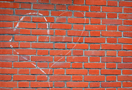heart sign drawn by white chalk on red brick wall, environment details photo