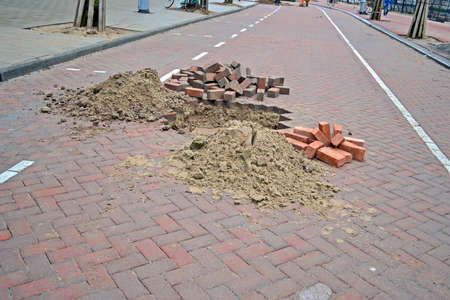 reconstruct: brick road under repair, modern brick  stone  highway reconstruction Stock Photo