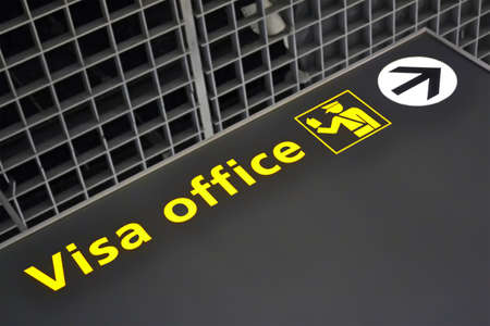 visa office direction sign, travel diversity details photo