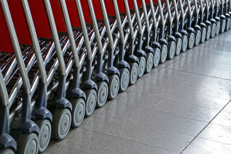 abstract silver small trolley with wheel heap for luggage transportation, airport details Stock Photo - 17905941