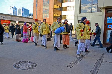 KIEV - MAR 05: Krishna religion people with drum and harmonic in Kiev, Ukraine on March 05, 2013. Stock Photo - 18368963