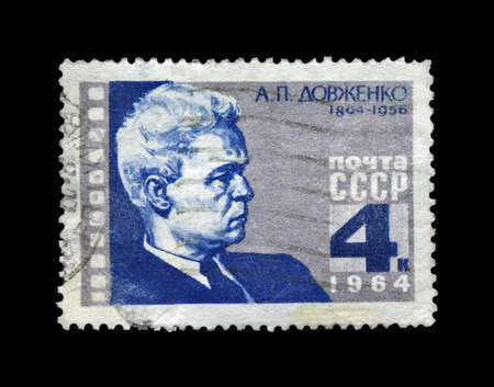 USSR - CIRCA 1964: canceled stamp printed in the USSR, shows famous ukrainian film producer Alexander Dovzhenko, circa 1964. vintage post stamp isolated on black background. 30th anniversary of Chapaev film production.