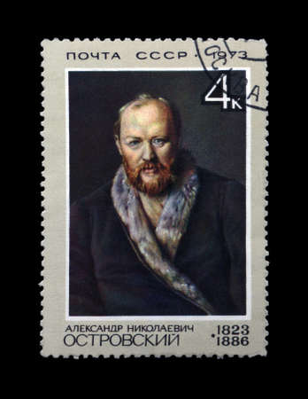 dramatist: USSR - CIRCA 1973: canceled stamp printed in the USSR, shows famous russian dramatist Alexander Ostrovsky (1823-1886), circa 1973. vintage post stamp isolated on black background.