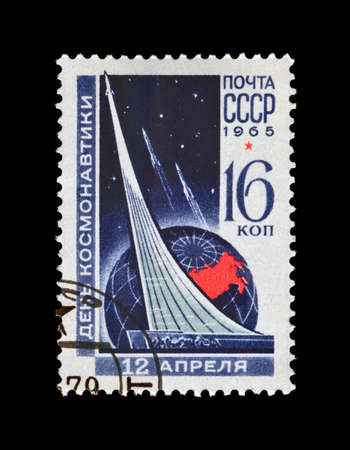 gagarin: USSR- CIRCA 1965, APR 12: cancelled stamp printed in USSR, shows cosmonauts monument (rocket) in Moscow, circa 1965. vintage post stamp on black background. National Cosmonauts Day. Editorial