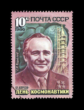 vostok: USSR-CIRCA 1986, APR 12: cancelled stamp printed in USSR, shows Sergei Korolev (1906-1966), rocket scientist, and Vostok spaceship, circa 1986. vintage post stamp on black background. National Cosmonauts Day.