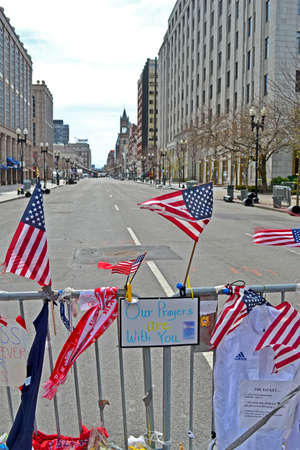 BOSTON - APR 20: American flags on Memorial set up on Boylston Street in Boston, USA on April 20, 2013. More 23300 runners take part in Marathon. 3 people killed and over 100s injured during Boston Marathon bombing on April 15, 2013.