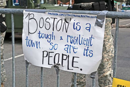 safety slogan: BOSTON - APR 20: Memorial set up on Boylston Street in Boston, USA on April 20, 2013. More 23300 runners take part in Marathon. 3 people killed and over 100s injured during Boston Marathon bombing on April 15, 2013.