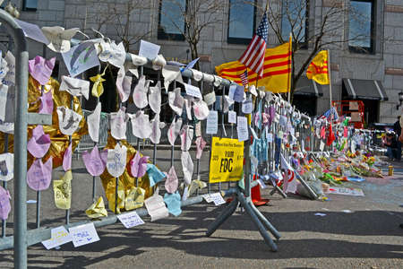BOSTON - APR 20: Memorial set up on Boylston Street in Boston, USA on April 20, 2013. More 23300 runners take part in Marathon. 3 people killed and over 100s injured during Boston Marathon bombing on April 15, 2013.