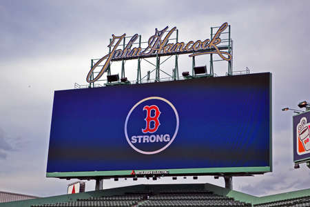 strong message: BOSTON - APR 20: Boston Strong message in Fenway Park, oldest professional sports venue in the United States, in Boston, USA on April 20, 2013. 3 people killed and over 100s injured during Boston Marathon bombing on April 15, 2013.