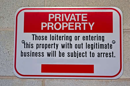 loitering: private property, warning message on stone wall Stock Photo