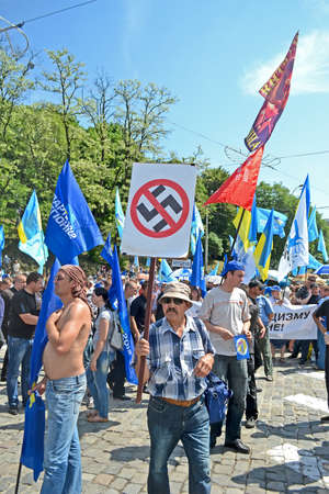 diversity of the region: KIEV - MAY 18: Political meeting against fascism on May 18, 2013 in Kiev, Ukraine. Man carry the anti-fascism sign.