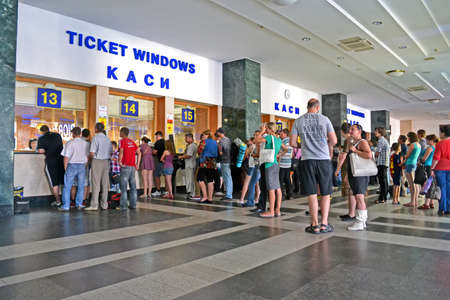 KIEV - JUN 17: Kiev Central Railway Station on June 17, 2013 in Kiev, Ukraine. 1st Railway Station was open in Kiev in 1868-1870 (project by architect Vishnevsky N.). Now it serves more 170000 passengers daily. People buying the tickets in tickets windows