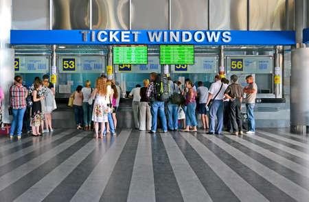 diversity of the region: KIEV - JUN 17: Kiev Central Railway Station on June 17, 2013 in Kiev, Ukraine. 1st Railway Station was open in Kiev in 1868-1870 (project by architect Vishnevsky N.). Now it serves more 170000 passengers daily. People buying the tickets in tickets windows