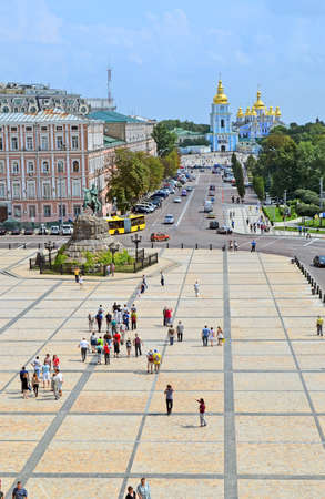 KIEV, UKRAINE - JUL 27: Michaels Cathedral and Bogdan Khmelnitsky monument on July 27, 2013 in Kiev, Ukraine. The monastery is located on the right side of the Dnieper River.