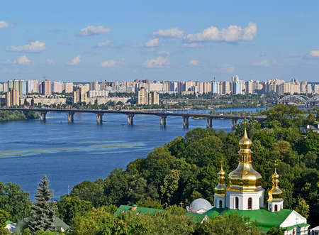 KIEV, UKRAINE - JUL 25 Kiev cityscape with Kiev-Pechersk Lavra and Dnieper river on July 25, 2013 in Kiev, Ukraine  Kiev celebrates 1025th anniversary of Kyivan Rus Christianity on July 26-28, 2013