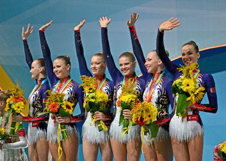 KIEV - AUG 31: 32nd Rhythmic Gymnastics World Championships on August 31, 2013 in Kiev, Ukraine. Belarus gymnasts on medal award ceremony. Editorial
