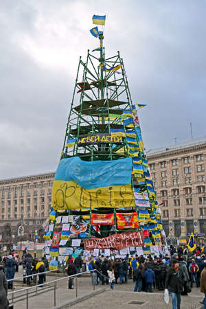 european integration: KIEV - DEC 05  Tree construction from flags with slogans on Euro maidan meeting in Kiev on December 05, 2013  Meeting devoted to declining of Ukraine for integration to the European Union