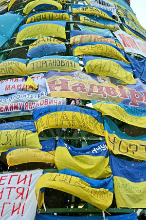 european integration: KIEV - DEC 06  Wall from flags on Euro maidan meeting in Kiev on December 06, 2013  Meeting devoted to declining of Ukraine for integration to the European Union