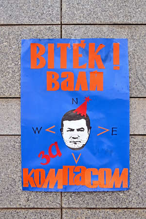 KIEV - DEC 06  Viktor please use correct compass as poster on stone wall on ukrainian language on Euro maidan meeting in Kiev on December 06, 2013  Meeting devoted to declining of Ukraine for integration to the European Union