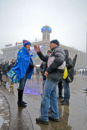 european integration: KIEV - DEC 06: People communicate on Euro maidan meeting in Kiev, Ukraine on December 06, 2013. Meeting devoted to declining of Ukraine for integration to the European Union.