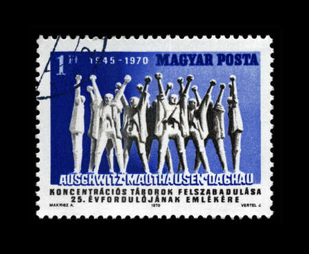treblinka: Auschwitz, Mauthausen, Dachau concentration camps liberation, cancelled stamp printed in Hungary, shows Monument to Hungarian Martyrs, circa 1970. 25th anniversary.