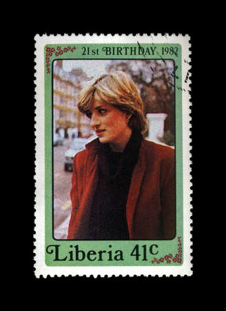 prince charles of england: LIBERIA - CIRCA 1982: cancelled stamp printed in Liberia shows 21st Birthday of princess Diana, circa 1982. vintage post stamp isolated on black background.