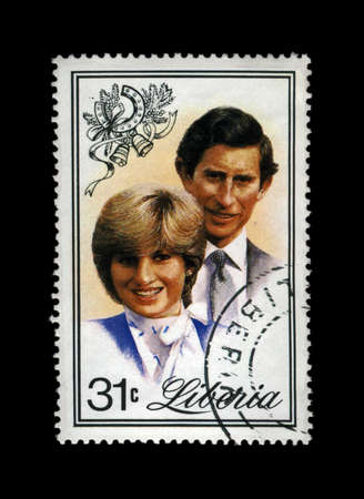 lady diana: LIBERIA - CIRCA 1982: cancelled stamp printed in Liberia shows marriage of Lady Diana Spencer and Prince Charles, circa 1982. vintage post stamp isolated on black background. Editorial